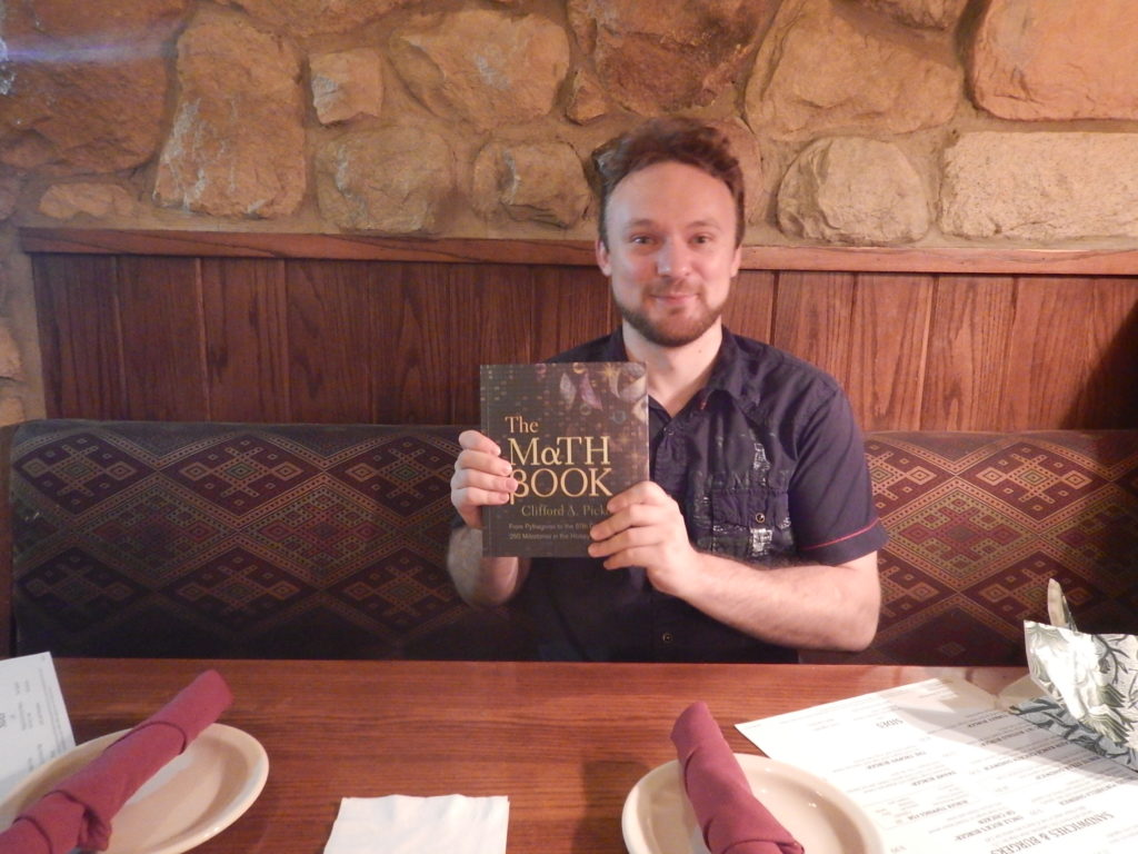 Mike, delighted with the top hundred mathematics discoveries book I gave him for his birthday in 2015.