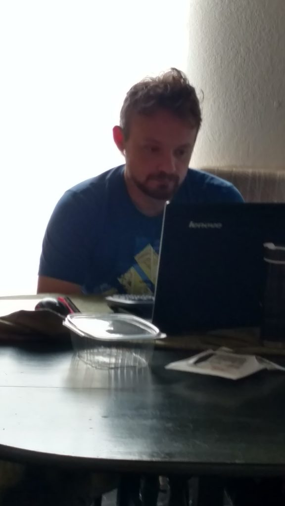 Mike, sleepy-headed, working from my dining room one morning.